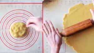 Roll the bottom crust of the pie. Use the rolling pin and roll on lightly floured flat surface.