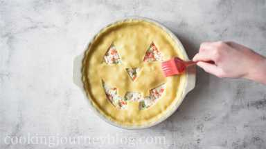 Brush the top of the pie with an egg.