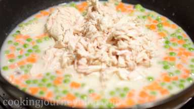 Add shredded chicken to the pan.