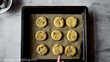 Transfer the cookies to the baking tray, layered with parchment paper. Leave the space between the cookies. Cut the cross on each cookie. Bake 15-20 minutes until golden.