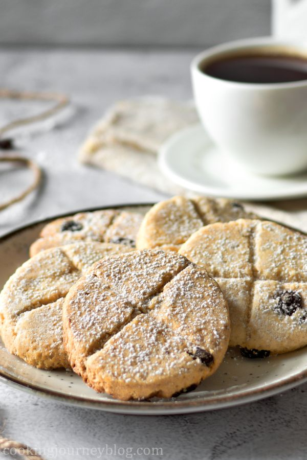 Traditional Soul Cakes served on a plate with a cup of black tea