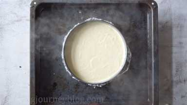 Fill the large baking tray with hot water until 1/3 of the cake pan. Bake 1 hour and 30 minutes until set, but slightly jiggly in center. Let it cool in the oven for 30 minutes, then open the door and let it cool further 30 minutes.