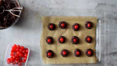 Put maraschino cherry in the well of each cookie. Bake for 10 minutes, then prepare another batch until all cookie dough is used.