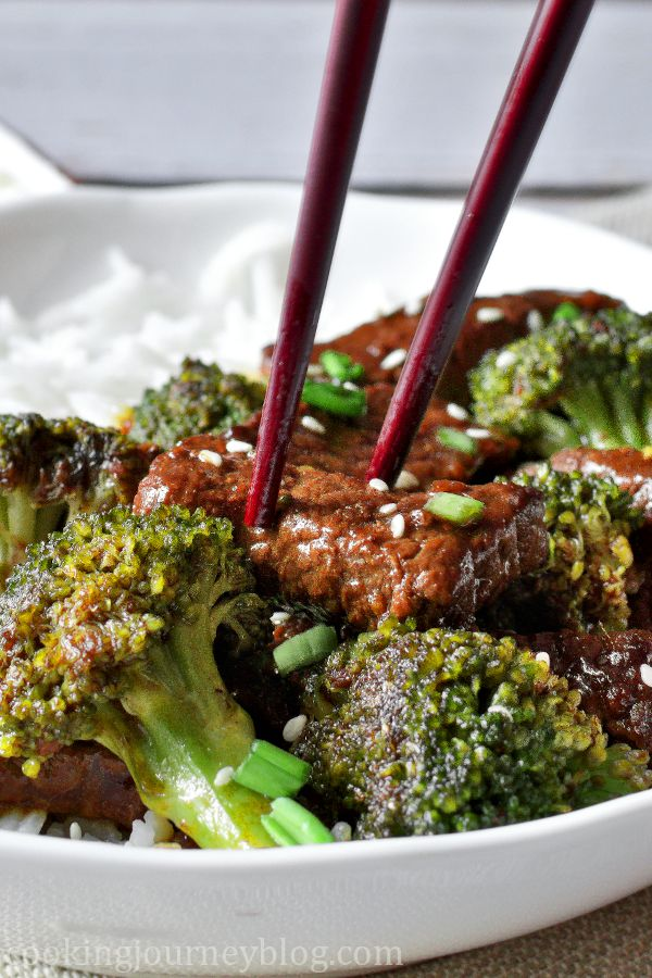 A close look at beef and broccoli stir fry with chopsticks