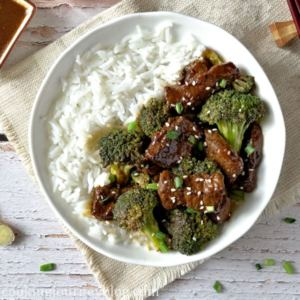 20 Minute Beef and Broccoli Stir Fry served in white bowl with rice