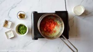 Add chopped small tomato to the pan. Cook few minutes.