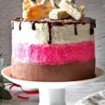 Festive Neapolitan Cake with 3 layers - chocolate, pink and white, decorated with chocolate ganache and wafers