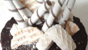 Decorate Neapolitan cake with wafers.