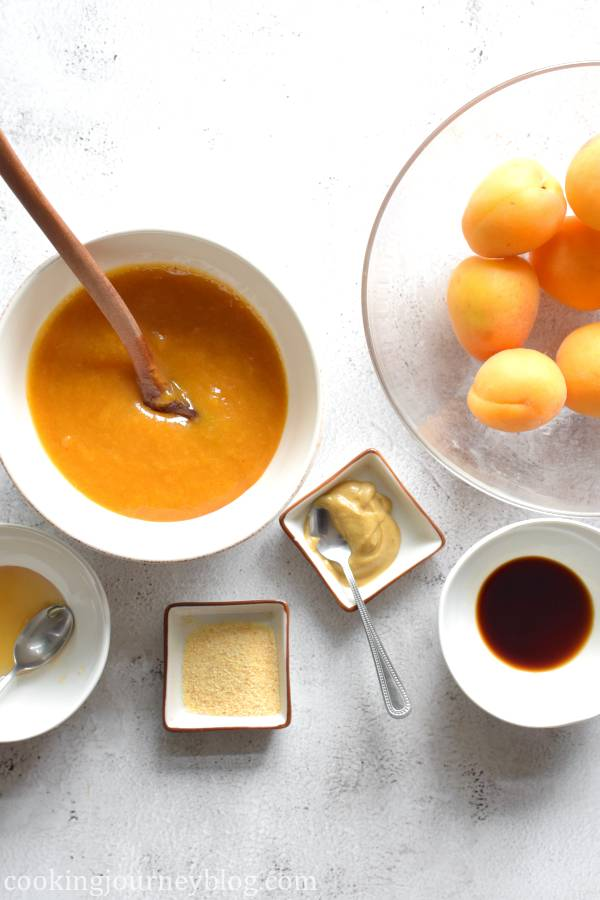 Ingredients for apricot chicken in different ramekins: homemade apricot sauce, honey, ginger and garlic powders, Dijon mustard, soy sauce and fresh apricots for decoration