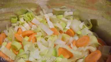 Add chopped garlic, leek and onion to the pot. Cook, stirring for a minute, then add vegetables.