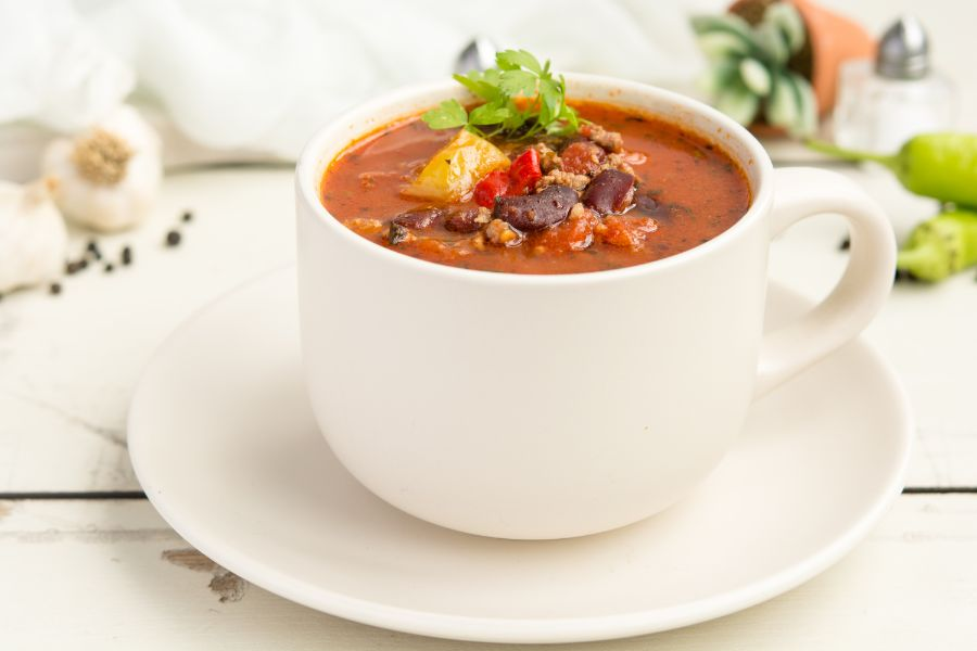 Taco soup served in the white cup