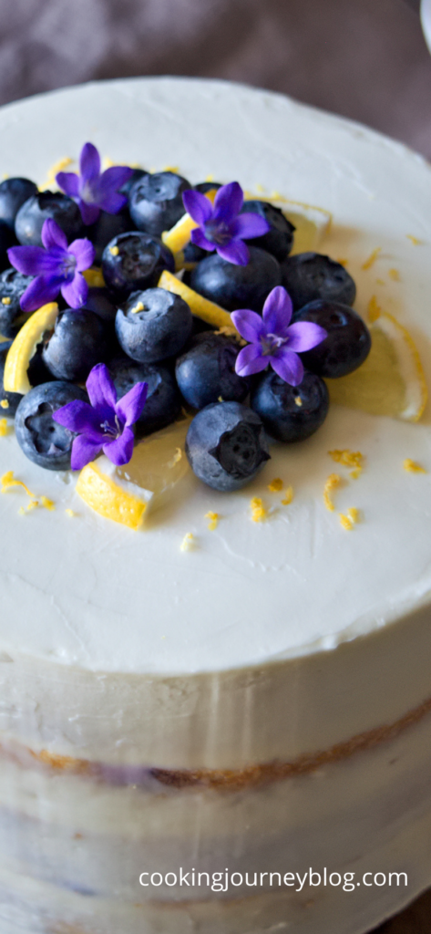 lemon blueberry cake with blueberries and lemon zest on top