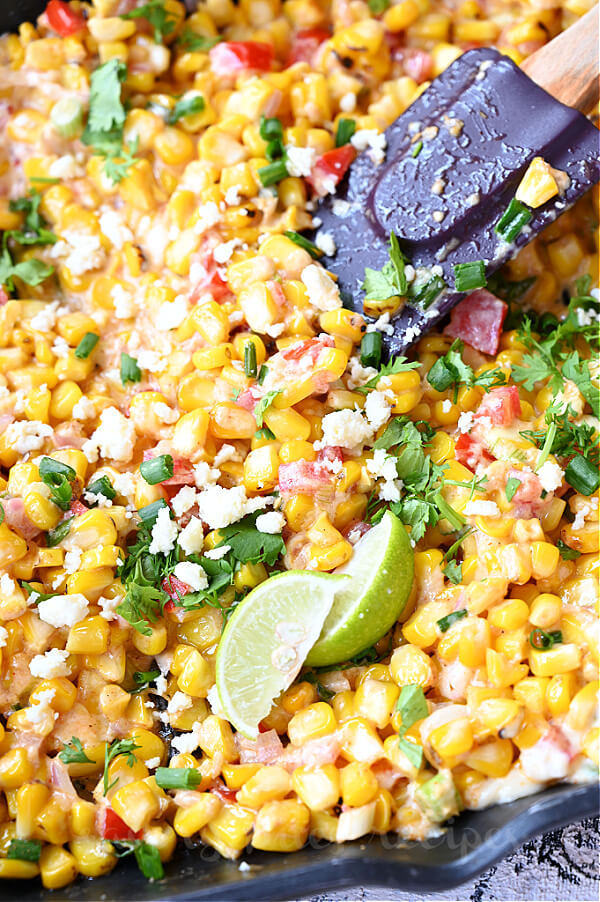 mexican street corn salad with grilled corn,chopped cilantro and cotija