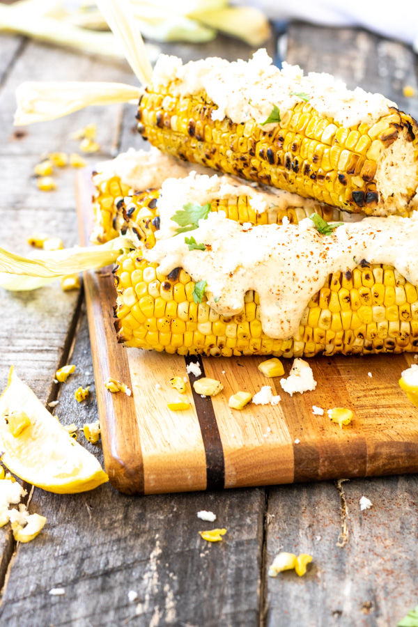 Corn on a hob served on the wooden board
