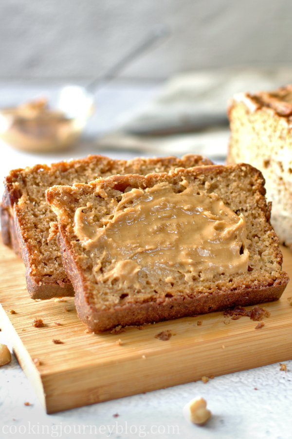 A slice or quick banana bread with peanut butter