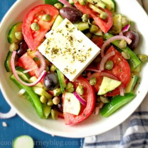 Horiatiki Greek salad served in a bowl, view from top