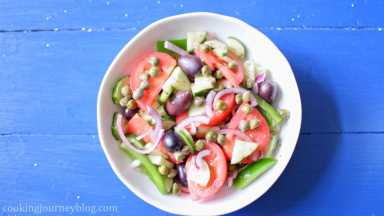 Serve salad on the plate, add 1-2 tsp of capers per serving.