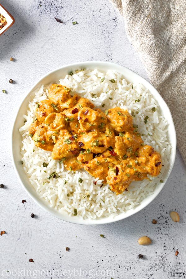 Peanut butter chicken served in the bowl with rice