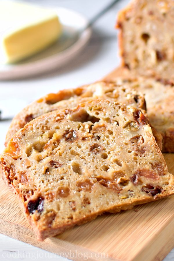 A slice of Irish Barmbrack on the wooden board